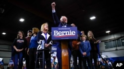 Democratic presidential candidate Sen. Bernie Sanders, accompanied by his wife Jane O'Meara Sanders and other family members speaks during a primary night election rally in Essex Junction, Vt., March 3, 2020.