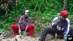 Villagers in Gundom, Cameroon, work on a US-paid sustainable clean water project
