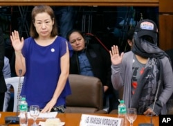 Choi Kyung-jin, left, widow of South Korean businessman Jee Ick-joo, and their former housekeeper, appear before Philippine Senate Committee.