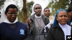 Catholic nuns pray near the Westgate Mall in Nairobi, Kenya, Sept. 25 2013.
