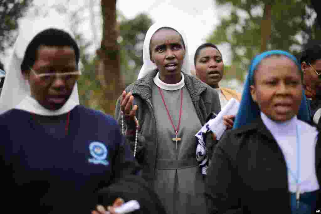 Catholic nuns pray near the Westgate Mall in Nairobi, Kenya, Sept. 25, 2013.