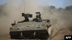 Israeli soldiers manuever a tank during a military exercise in the northern part of the Israeli-annexed Golan Heights on Sept. 7, 2017. Syria said Israeli airstrikes hit a facility in the country's west linked by Western nations to Syria's chemical weapons program.
