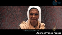 FILE - This grab from a video provided by the SITE Intelligence Group taken on July 2, 2017, shows Colombian nun Gloria Cecilia Narvaez, one of six hostages then held by al-Qaida's Mali branch.