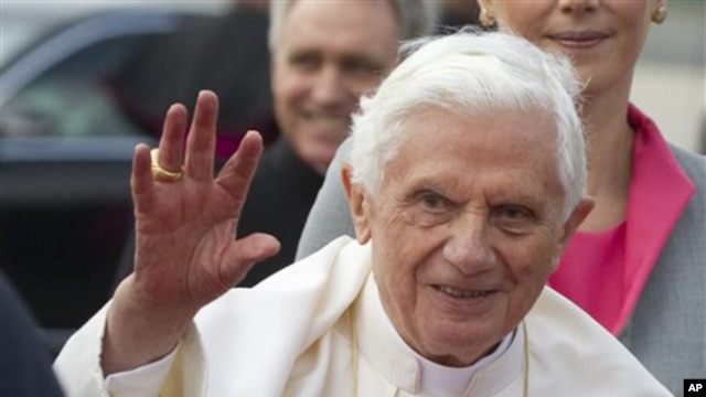 Pope Benedict XVI waves after his arrival at Tegel airport in Berlin, Germany, Thursday, Sept. 22, 2011.