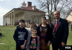 Bibi Mariam Jamalzai (C) poses for a photo with her family on the day that she became an American citizen at Mount Vernon Feb. 22, 2017. With Jamalzai are her husband, Azmat (R) and their three children, from left, Ahmad, Sara and Mustafa.