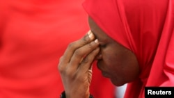 A woman takes part in a protest for the release of the abducted secondary school girls in the remote village of Chibok, during a sit-in protest at the Unity fountain Abuja, May 12, 2014. The leader of the Nigerian Islamist rebel group Boko Haram has offe