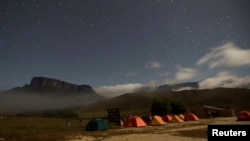 Mt. Kukenan (L) and Mt. Roraima are seen from the Tec Camp, near Venezuela's border with Brazil, Jan. 14, 2015.