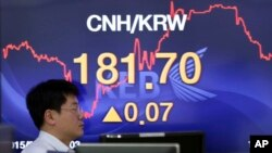 A screen showing the foreign exchange rate between the China and South Korea at a bank in Seoul, South Korea. China's currency recently was devalued as other major trading currencies' exchange rates fell. Thursday, the IMF chose to wait until next year to decide if it would include the yuan as a reserve currency.