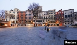 """A general view of the """"campo,"""" or square at the center of the world's first ghetto in Venice, northern Italy, March 22, 2016."""