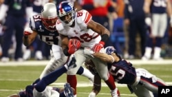 Giants offense leads New York to Super Bowl win over New England Patriots.