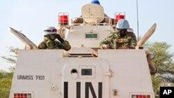 FILE - Highway attacks in South Sudan aren't a new issue. Here, U.N. peacekeepers lead a patrol from Bentiu toward Nhialdiu, part of an increase in patrols.