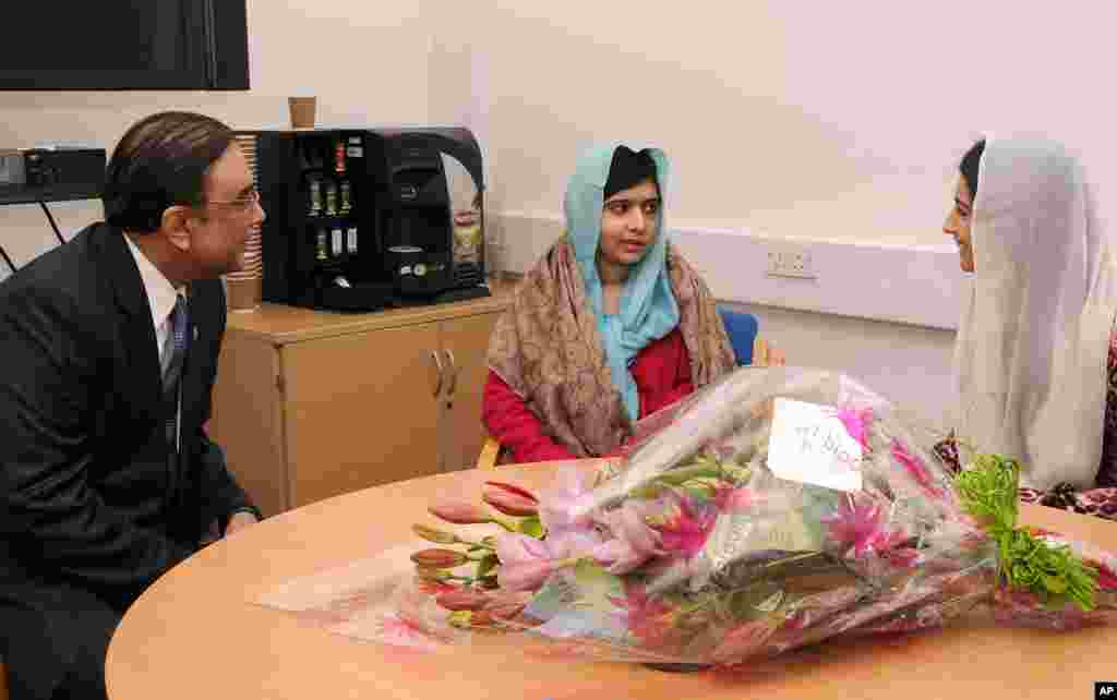 This photo provided by the Queen Elizabeth Hospital Birmingham shows Pakistan's President Asif Ali Zardari, and his daughter Asifa Bhutto, right, meeting with Malala Yousafzai at the hospital, December 8, 2012.