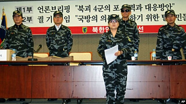 Members of the NKPLF reading petition before submitting it to the S Korean Defense Ministry