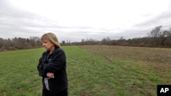 "In this April 12, 2016 photo, Desiree Moninski, walks on land located across from her house in Dudley, Mass., which is the site of a proposed Muslim cemetery, a project vigorously opposed by area residents. Regarding the land once farmed by her grandparents, Moninski said she and other opponents have legitimate concerns that have nothing to do with Islam. ""I grew up here. It's farmland, and I'd like to see it stay that way,"" she said."