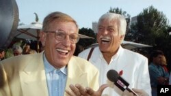 FILE - Jerry Van Dyke, left, and his brother, Dick, laugh during a party in Los Angeles, Aug. 25, 1992. Jerry Van Dyke died Friday at his ranch in Arkansas at age 86.