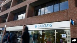 Pedestrians pass a branch of Barclays Bank in Swiss Cottage in London, Sept. 20, 2013.