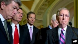 From left, Sen. Roy Blunt, R-Mo., Sen. John Barrasso, R-Wyo., Sen. John Thune, R-S.D., Senate Minority Whip John Cornyn of Texas, and Senate Minority Leader Mitch McConnell R-Ky., pause during a news conference on Capitol Hill in Washington, Nov. 18, 2014