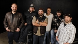 The Zac Brown Band, from left, John Driskell Hopkins, Coy Bowles, Zac Brown, Jimmy De Martini, Clay Cook, and Chris Fryar are shown in Nashville, Tennessee, Dec. 29, 2010.