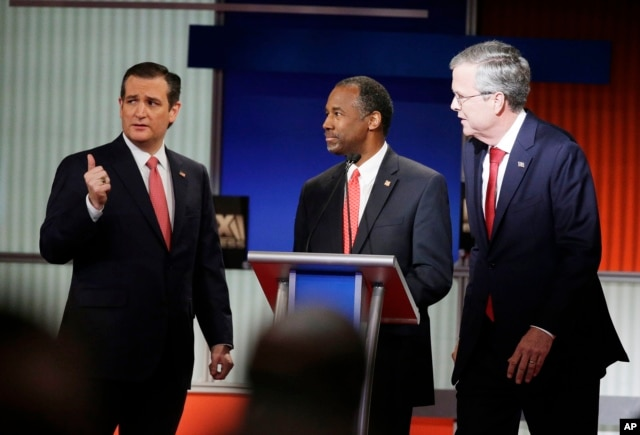 Republican presidential candidates Sen. Ted Cruz, left, retired neurosurgeon Ben Carson and former Florida Gov. Jeb Bush chat during the Fox Business Network Republican presidential debate in North Charleston, S.C., Jan. 15, 2016.
