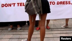 FILE - A woman wearing a miniskirt takes part in a protest in Jakarta against the idea that provocatively dressed women are to blame for sexual assaults.