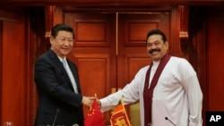 2014年9月21日習近平訪斯里蘭卡與拉賈帕克薩總統見面。