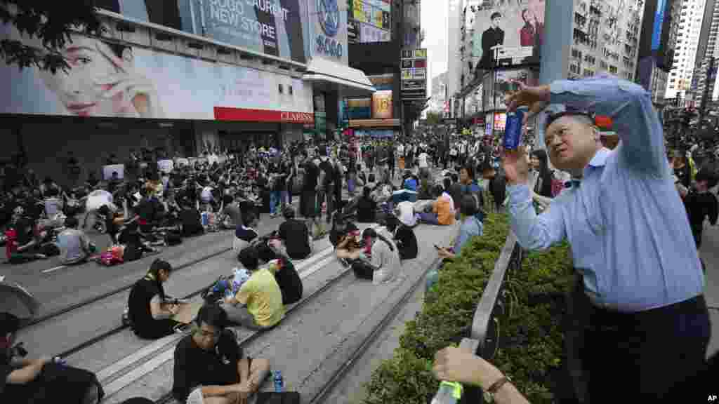 A visitor takes a photo of a sit-in protest in Hong Kong, Sept. 29, 2014.