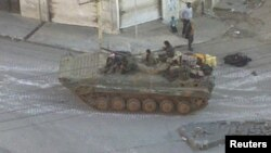 A Syrian army tank is seen in the Zabadani neighborhood of Damascus. (file photo)