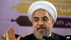 Tổng thống Iran Hassan Rouhani phát biểu trong một cuộc họp báo ở Tehran, Iran, ngày 14 tháng 6, 2014.