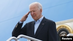 President Joe Biden salutes while boarding Air Force One as he departs on travel to attend the G-7 Summit in England, the first foreign trip of his presidency, from Joint Base Andrews, Maryland, June 9, 2021.