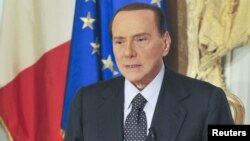 Former Italian Prime Minister Silvio Berlusconi speaks during his video message recording where he confirmed that he would not lead his centre-right People of Freedom (PDL) party in next year's election in Rome, October 25, 2012.