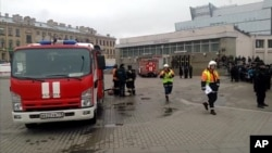 In this image taken from video footage, emergency services work outside Sennaya Square metro station in St Petersburg, Russia, April 3, 2017.