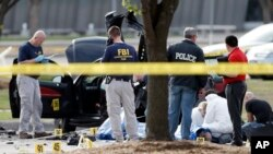 Police shot and killed two gunmen after they opened fire on a security officer outside Curtis Culwell Center in Garland, Texas, Monday, May 4, 2015. The center was hosting a contest for Prophet Muhammad cartoons. (AP Photo/Brandon Wade)