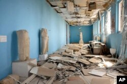 This photo released on Sunday March 27, 2016, by the Syrian official news agency SANA, shows destroyed statues at the damaged Palmyra Museum, in Palmyra city, central Syria.