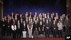 President Barack Obama poses for a group photo with leaders attending the Open Government Partnership in New York, Tuesday, Sept. 20, 2011. (AP Photo/Pablo Martinez Monsivais)