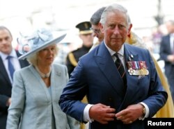 FILE - Britain's Prince Charles and his wife Camilla, Duchess of Cornwall arrive at Westminster Abbey in central London, May 10, 2015.