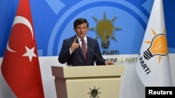Turkey's Prime Minister Ahmet Davutoglu speaks during a news conference at his ruling AK Party (AKP) headquarters in Ankara, Turkey, August 13, 2015. Turkey faces a snap election this autumn after talks on forming a coalition government broke down on Thur