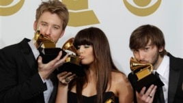Lady Antebellum, from left, Charles Kelley, Hillary Scott and Dave Haywood pose backstage with the award for best record of the year at the 53rd annual Grammy Awards on Sunday, Feb. 13, 2011, in Los Angeles.