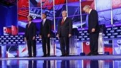 از چپ به راست: ریک سانتروم، میت رمنی، نوت گینگریچ و ران ٔپل کاندیداهای جمهوری خواه ریاست جمهوری آمریکا در مناظره تلویزیونی در شهر چارلستون در ایالت کارولینای جنوبی، پنجشنبه نوزدهم ژانویه