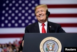 FILE - U.S. President Donald Trump speaks during a rally in Grand Rapids, Michigan, March 28, 2019.