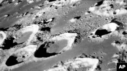 FILE - This Dec. 29, 1968, photo made available by NASA shows craters on the moon. For the past 290 million years, giant rocks from space have been crashing into Earth more than twice as often as they did in the previous 700 million years, according to a new study.
