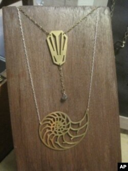 Katie Miller's sheet metal jewelry designs