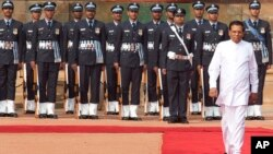 Sri Lanka's President Maithripala Sirisena inspects a guard of honor during a ceremonial reception at the Indian Presidential Palace in New Delhi, India, Feb. 16, 2015.