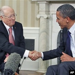FILE - President Barack Obama meets with Prime Minister Beji Caid Essebsi of Tunisia in the Oval Office at the White House in Washington, Oct. 7, 2011.