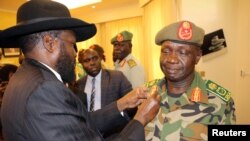 South Sudan's President Salva Kiir decorates newly appointed army chief General James Ajongo during his swearing-in ceremony at the Presidential Palace in Juba, South Sudan, May 10, 2017.
