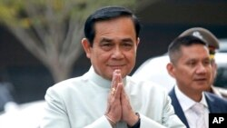 Thai Prime Minister Prayuth Chan-ocha, arrives at the government house for a cabinet meeting in Bangkok, Thailand, Tuesday, Oct. 2, 2018. (AP Photo/Sakchai Lalit)