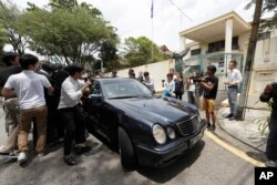 Media chases a car which came out from North Korean Embassy in Kuala Lumpur, Malaysia, Feb. 22, 2017.