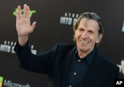 "FILE - Leonard Nimoy arrives at the Los Angeles premiere of ""Star Trek Into Darkness"" at the Dolby Theater, May 14, 2013."