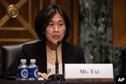 FILE - Katherine Tai, then-nominee for U.S. trade representative, testifies before a Senate Finance Committee hearing on Capitol Hill, Feb. 25, 2021.
