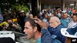 An activist is detained by Cuban security officers ahead of a march marking International Human Rights Day,Cuba. (File)