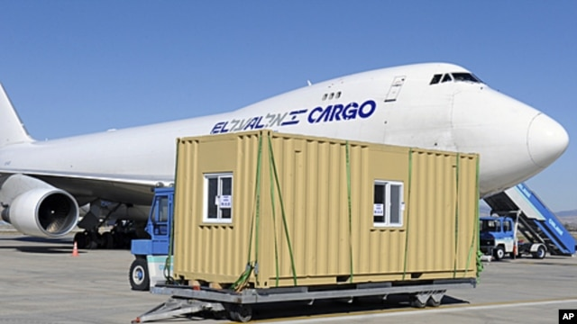 A prefabricated home sent by Israel is seen next to an Israeli cargo plane before being transported to the earthquake zone, at Esenboga airport in Ankara October 27, 2011.